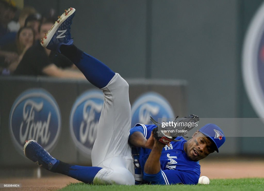 Curtis Granderson #18 of the Toronto Blue Jays can't come up with the catch in foul territory of the ball hit by Eddie Rosario #20 of the Minnesota Twins during the first inning of the game on May 1, 2018 at Target Field in Minneapolis, Minnesota.