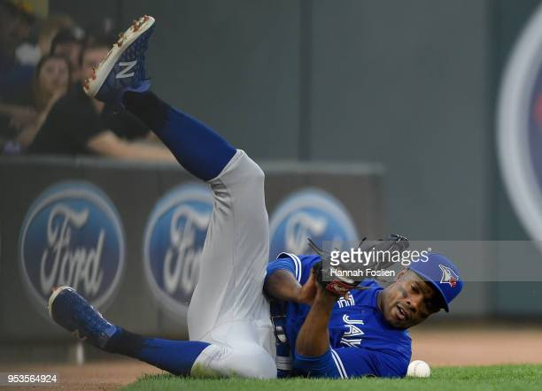 Curtis Granderson of the Toronto Blue Jays can't come up with the catch in foul territory of the ball hit by Eddie Rosario of the Minnesota Twins...