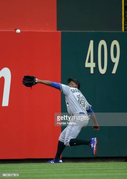 Curtis Granderson of the Toronto Blue Jays catches a deep fly ball in center field in the fourth inning during a game against the Philadelphia...