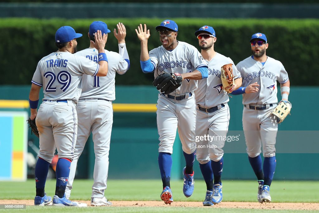 Curtis Granderson #18 of the Toronto Blue Jays celebrates a win over the Detroit Tigers with his teammates at Comerica Park on June 3, 2018 in Detroit, Michigan. Toronto defeated Detroit 8-4.