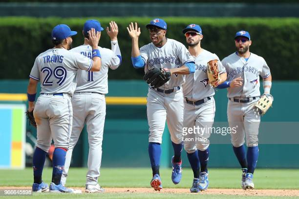 Curtis Granderson of the Toronto Blue Jays celebrates a win over the Detroit Tigers with his teammates at Comerica Park on June 3 2018 in Detroit...