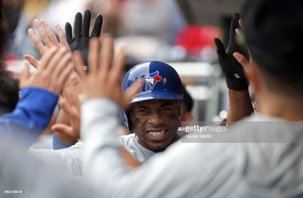 Curtis Granderson #18 of the Toronto Blue Jays high-fives teammates in the dugout after hitting a solo home run in the ninth inning during a game against the Philadelphia Phillies at Citizens Bank Park on May 27, 2018 in Philadelphia, Pennsylvania. The Blue Jays won 5-3.