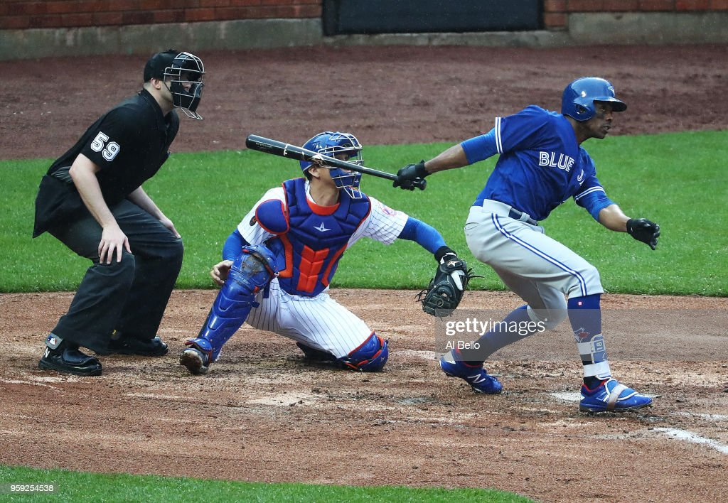 Curtis Granderson #18 of the Toronto Blue Jays hits a double in the fifth inning against the New York Mets during their game at Citi Field on May 16, 2018 in New York City.