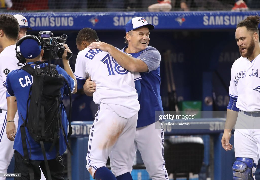 Curtis Granderson #18 of the Toronto Blue Jays is congratulated by manager John Gibbons #5 after hitting a game-winning solo home run in the tenth inning during MLB game action against the Boston Red Sox at Rogers Centre on April 24, 2018 in Toronto, Canada.