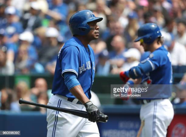 Curtis Granderson of the Toronto Blue Jays reacts after striking out in the third inning as Josh Donaldson looks on from the ondeck circle during MLB...