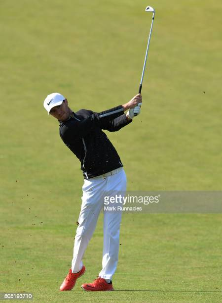 Curtis Griffiths of England plays his second shot to the 1st hole during the third day of the 2017 SSE Scottish Hydro Challenge hosted by MacDonald...