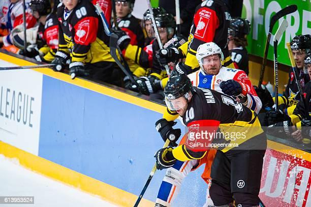 Curtis Hamilton of Lappeenranta hits Martin Roymark of Tampere during the Champions Hockey League Round of 32 match between SaiPa Lappeenranta and...