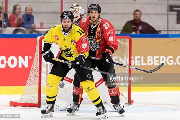 Curtis Hamilton of SaiPa Lappeenranta infront of Brendan Mikkelson of Lulea Hockey and Filip Gustafsson Goaltender of Lulea Hockey during the...