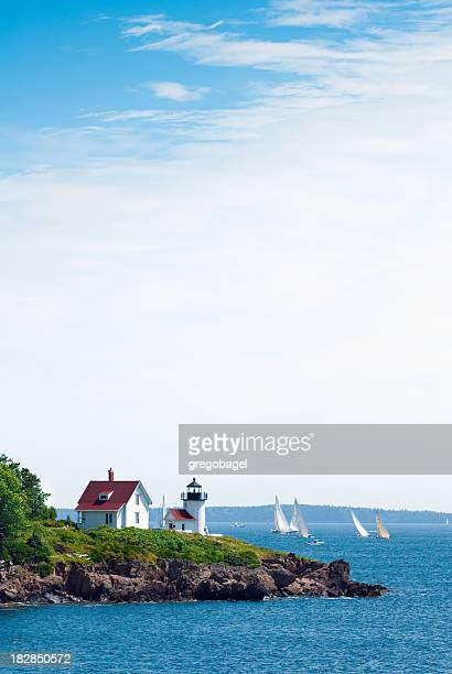 Curtis Head Light in Camden, ME with ocean and sailboats