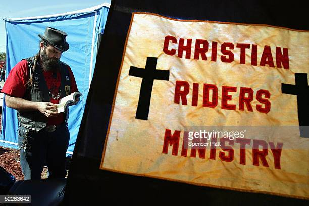 Curtis Hubble a Chaplin with Christian Riders Ministry reflects before giving a sermon at Bike Week March 6 2005 in Daytona Beach Florida The...