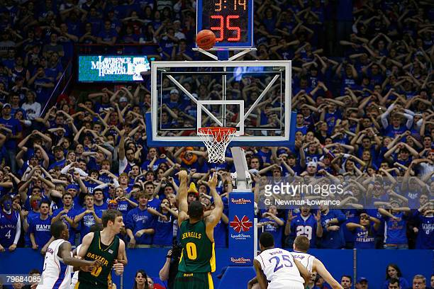 Curtis Jerrells of the Baylor Bears shoots a free throw as Kansas fans attempt to distract him on February 9, 2008 at Allen Fieldhouse in Lawrence,...