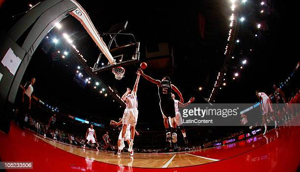 Curtis Jerrells of the San Antonio Spurs drives against Chris Kaman of the Los Angeles Clippers during a preseason game on October 12 2010 at the...