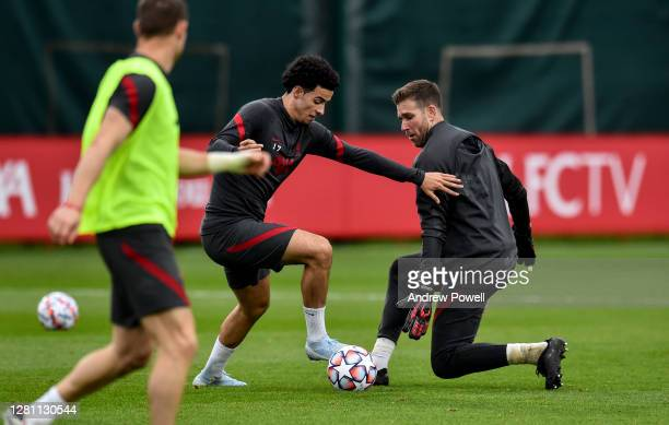 Curtis Jones and Adrian of Liverpool during a training session at Melwood Training Ground on October 19 2020 in Liverpool England