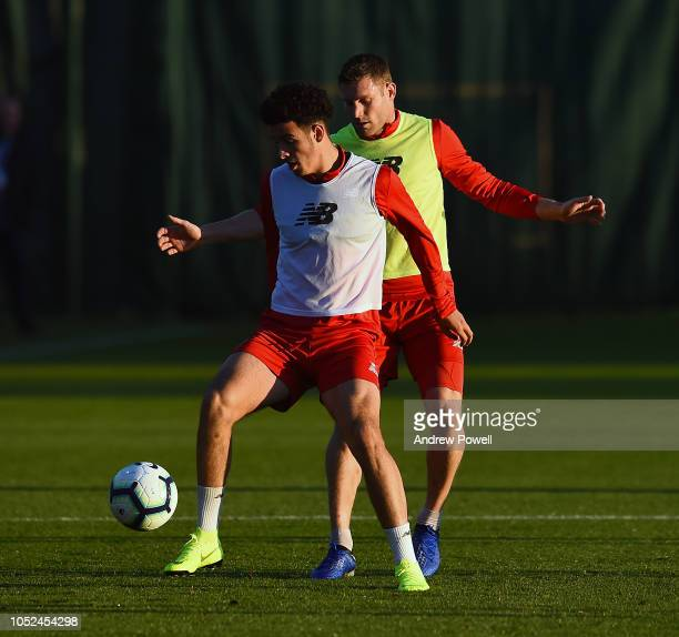 Curtis Jones and James Milner of Liverpool during a training session at Melwood Training Ground on October 18 2018 in Liverpool England