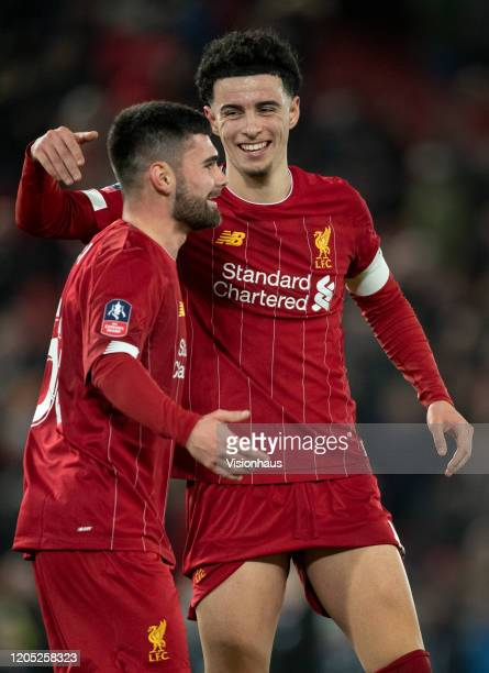Curtis Jones and Joseph Hardy of Liverpool celebrate at the final whistle after the FA Cup Fourth Round Replay match between Liverpool and Shrewsbury...