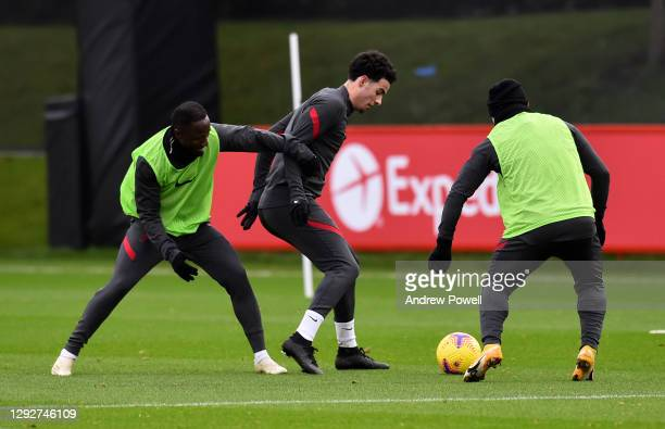 Curtis Jones and Naby Keita during a training session at AXA Training Centre on December 23, 2020 in Kirkby, England.