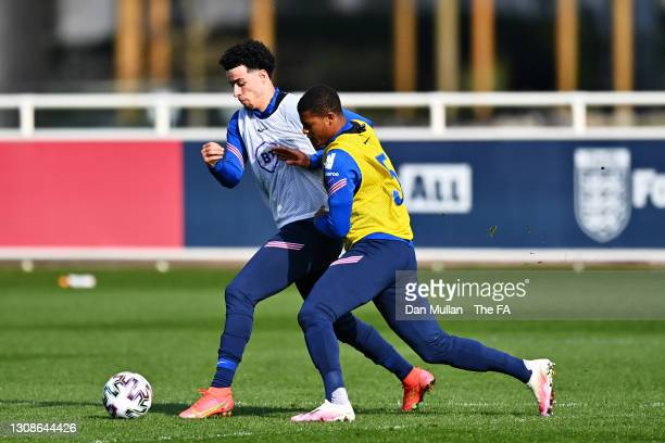 Curtis Jones and Rhian Brewster of England battle for the ball during the England U21 Training Session at St George's Park on March 22, 2021 in...