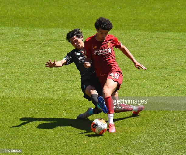 Curtis Jones and Takumi Minamino of Liverpool during a training session at Anfield on June 01, 2020 in Liverpool, England.