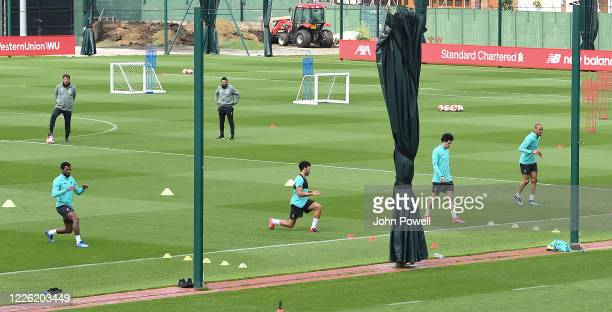 Curtis Jones Georginio Wijnaldum Alex OxladeChamberlain and Fabinho of Liverpool during a training session at Melwood Training Ground on May 21 2020...