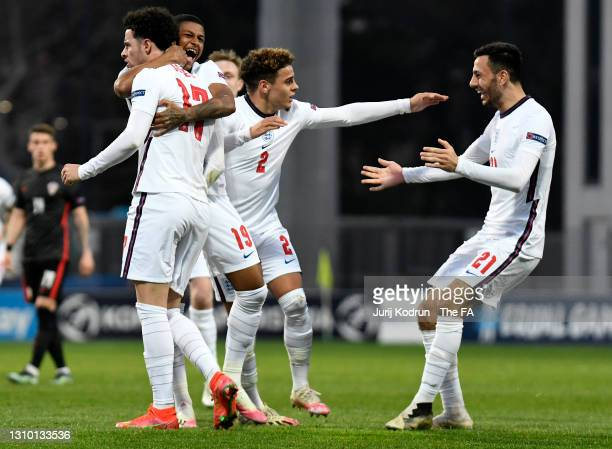 Curtis Jones of England celebrates after scoring their team's second goal with teammates Rhian Brewster, Max Aarons and Dwight McNeil during the 2021...