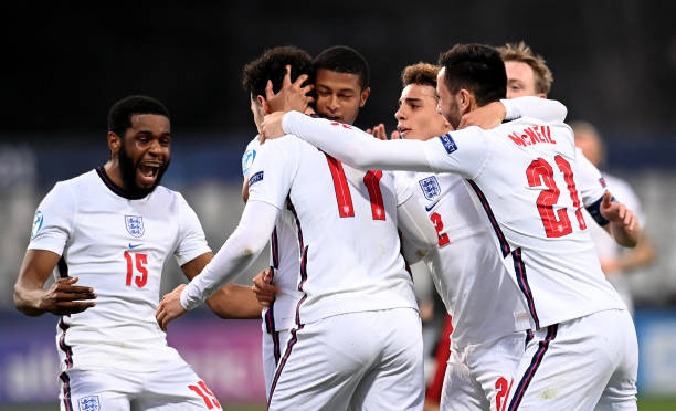 Curtis Jones of England celebrates with team mates after scoring their side's second goal during the 2021 UEFA European Under-21 Championship Group D...