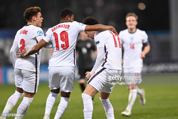 Curtis Jones of England celebrates with team mates Rhian Brewster and Lloyd Kelly during the 2021 after scoring their side's second goal UEFA...