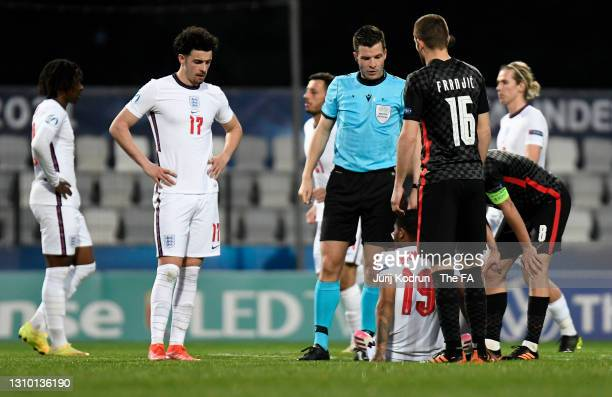 Curtis Jones of England looks on as his team mate Rhian Brewster receives medical treatment during the 2021 UEFA European Under-21 Championship Group...