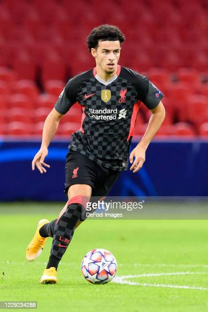 Curtis Jones of FC Liverpool controls the ball during the UEFA Champions League Group D stage match between Ajax Amsterdam and Liverpool FC at Johan...