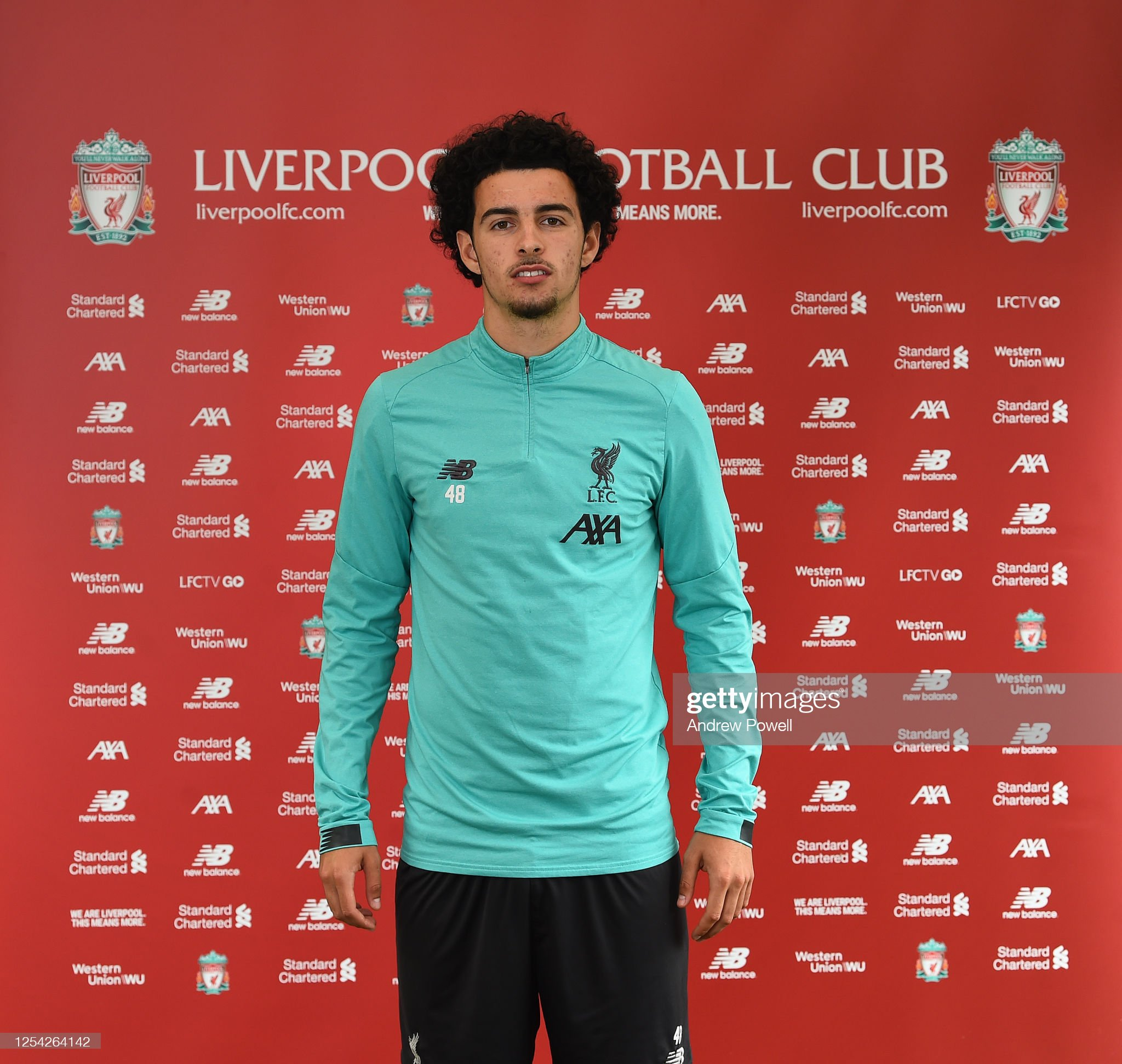 https://media.gettyimages.com/photos/curtis-jones-of-liverpool-after-signing-an-contract-extension-at-picture-id1254264142?s=2048x2048