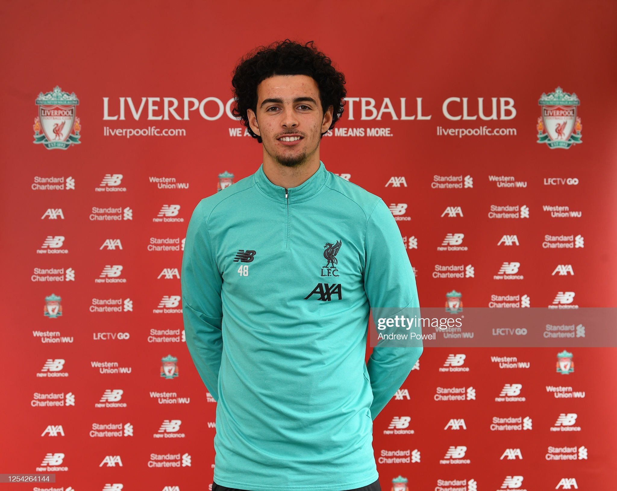 https://media.gettyimages.com/photos/curtis-jones-of-liverpool-after-signing-an-contract-extension-at-picture-id1254264144?s=2048x2048