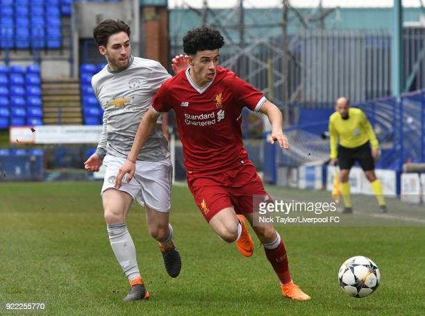 Curtis Jones of Liverpool and Aidy Barlow of Manchester United in action during the Liverpool v Manchester United UEFA Youth League game at Prenton...