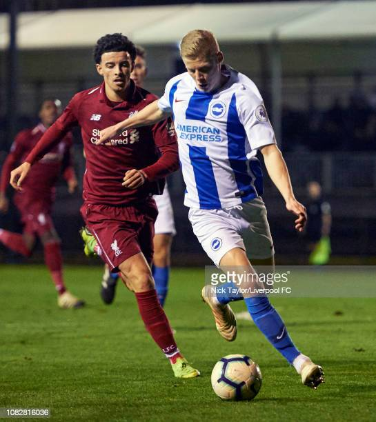 Curtis Jones of Liverpool and Alex Cochrane of Brighton and Hove Albion in action during the PL2 game at The Kirkby Academy on January 14 2019 in...