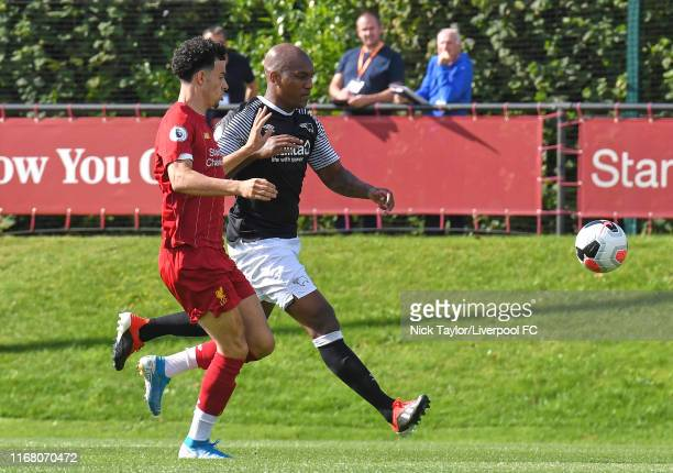 Curtis Jones of Liverpool and Andre Wisdom of Derby County in action during the PL2 game at The Kirkby Academy on September 14 2019 in Kirkby England