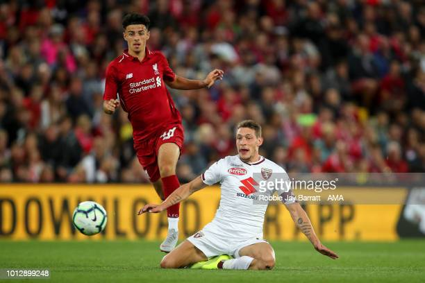 Curtis Jones of Liverpool and Andrea Belotti of Torino during the preseason friendly between Liverpool and Torino at Anfield on August 7 2018 in...