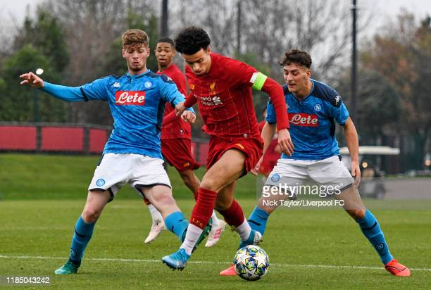 Curtis Jones of Liverpool and Antonio D'Amato of Napoli in action during the UEFA Youth League game at The Kirkby Academy on November 27, 2019 in...