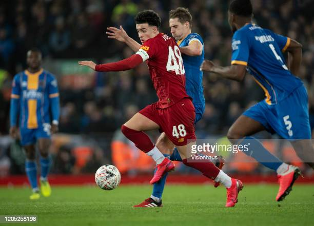 Curtis Jones of Liverpool and David Edwards of Shrewsbury Town in action during the FA Cup Fourth Round Replay match between Liverpool and Shrewsbury...