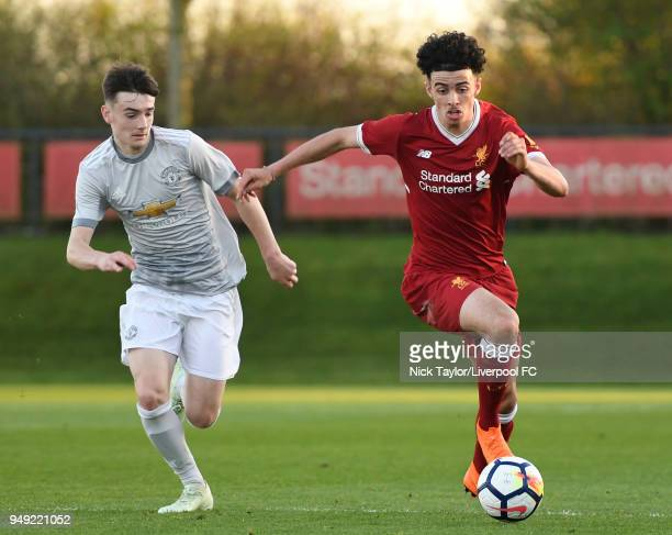 Curtis Jones of Liverpool and Dylan Levitt of Manchester United in action during the Liverpool v Manchester United U18 Premier League game at The...