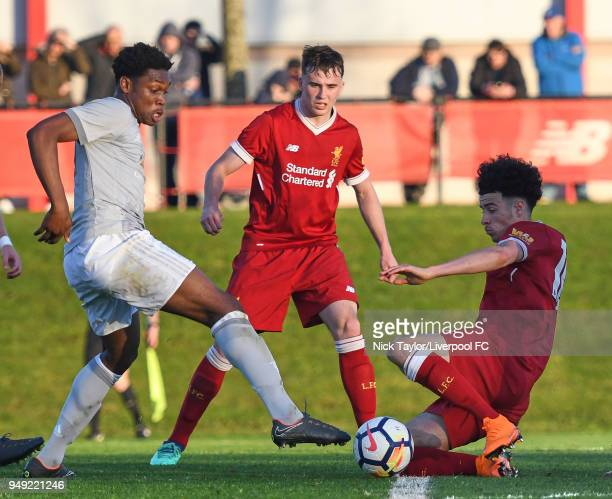 Curtis Jones of Liverpool and Ethan Laird of Manchester United in action during the Liverpool v Manchester United U18 Premier League game at The...