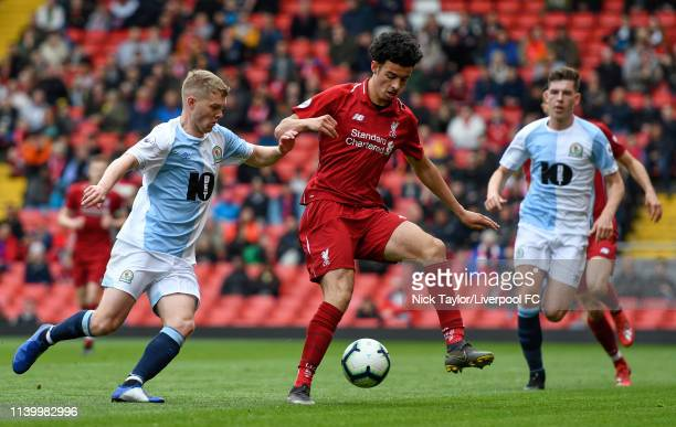 Curtis Jones of Liverpool and Jacob Davenport of Blackburn Rovers in action during the PL2 match at Anfield on April 28 2019 in Liverpool England