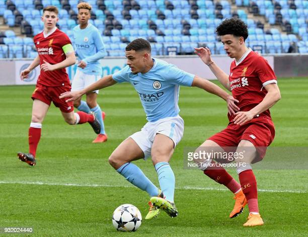 Curtis Jones of Liverpool and Joel Latibeaudiere of Manchester City in action during the Manchester City v Liverpool UEFA Youth League game at...