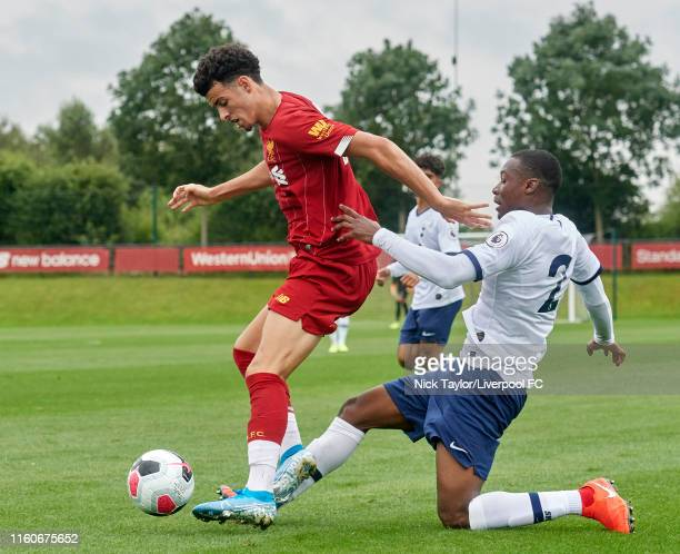 Curtis Jones of Liverpool and Jubril Okedina of Tottenham Hotspur in action during the PL2 game at The Kirkby Academy on August 10 2019 in Kirkby...