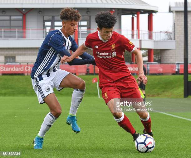 Curtis Jones of Liverpool and Muio Hau of West Bromwich Albion in action during the Liverpool v West Bromwich Albion U18 Premier League game at The...