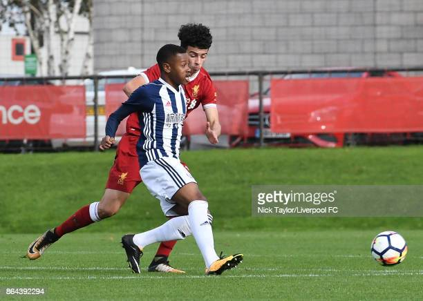 Curtis Jones of Liverpool and Rayhaan Tulloch of West Bromwich Albion in action during the Liverpool v West Bromwich Albion U18 Premier League game...