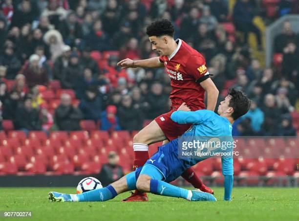 Curtis Jones of Liverpool and Robbie Burton of Arsenal in action during the FA Youth Cup fourth round match between Liverpool and Arsenal at Anfield...
