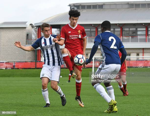 Curtis Jones of Liverpool and Sam Wilding of West Bromwich Albion in action during the Liverpool v West Bromwich Albion U18 Premier League game at...