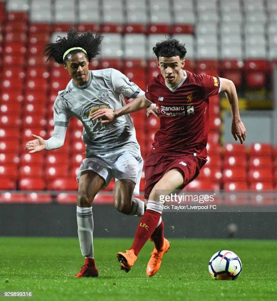 Curtis Jones of Liverpool and Tahith Chong of Manchester United in action during the Premier League 2 match between Liverpool and Manchester United...
