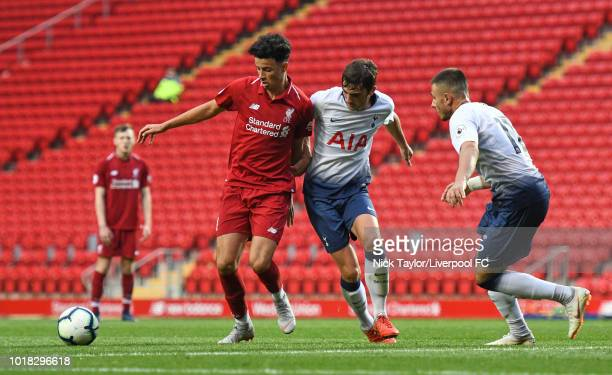 Curtis Jones of Liverpool and Troy Parrott and Anthony Georgiou of Tottenham Hotspur in action during the Liverpool v Tottenham Hotspur PL2 game at...