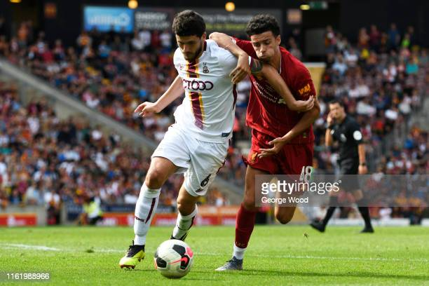 Curtis Jones of Liverpool battles for possession with Anthony O'Connor of Bradford City during the PreSeason Friendly match between Bradford City and...