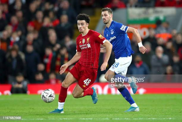 Curtis Jones of Liverpool battles for possession with Morgan Schneiderlin of Everton during the FA Cup Third Round match between Liverpool and...