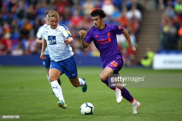 Curtis Jones of Liverpool battles with Jay Harris of Tranmere Rovers during the PreSeason Friendly match between Tranmere Rovers and Liverpool at...